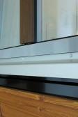 Větrací systém AEROMAT pod oknem PROGRESSION, je možné i skryté zabudování