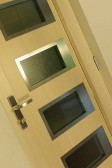 NAVY - dřevohliníkové vchodové dveře konstrukce STYLE, zevnitř